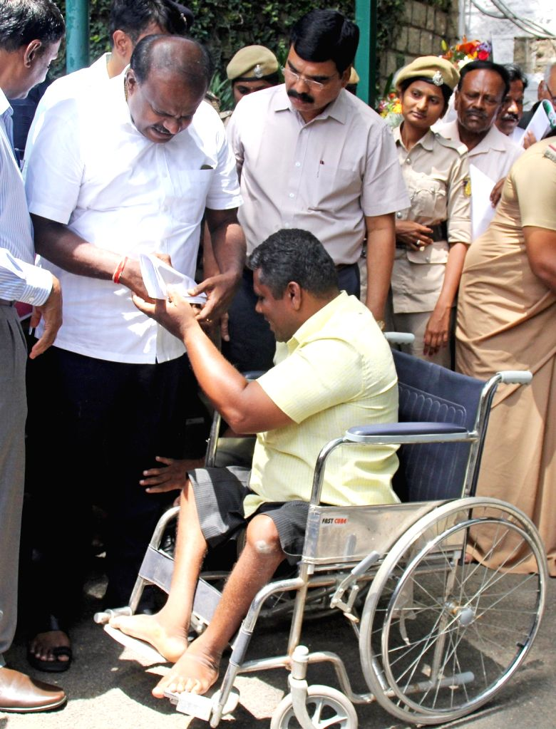 Karnataka Chief Minister H.D. Kumaraswamy listens to the grievances of people during 'Janatha Darshana', in Bengaluru on May 29, 2018. - H.