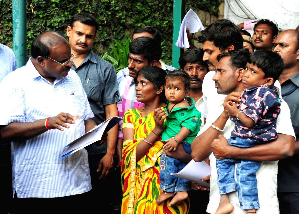 Karnataka Chief Minister H.D. Kumaraswamy listens to public grievances during Janata Darshan programme, in Bengaluru on June 4, 2018. - H.