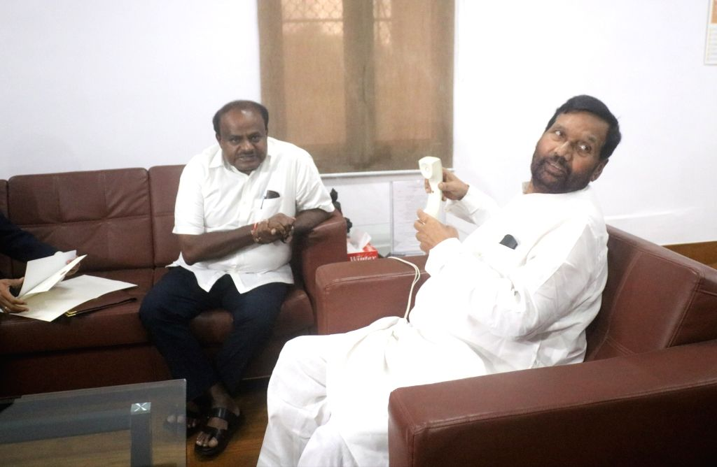 Karnataka Chief Minister H.D. Kumaraswamy meets Union Consumer Affairs, Food and Public Distribution Minister Ram Vilas Paswan, in New Delhi on July 17, 2018. - H.