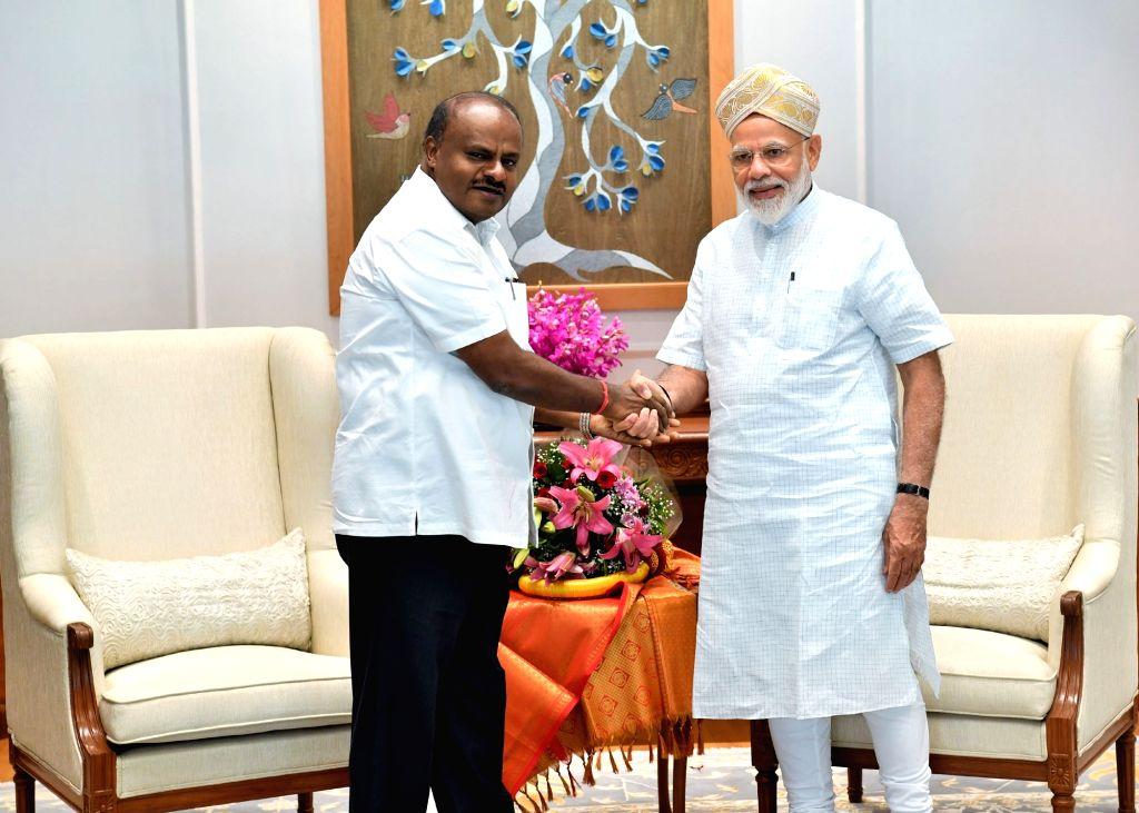 Karnataka Chief Minister H.D. Kumaraswamy meets Prime Minister Narendra Modi, in New Delhi on June 15, 2019. - H. and Narendra Modi