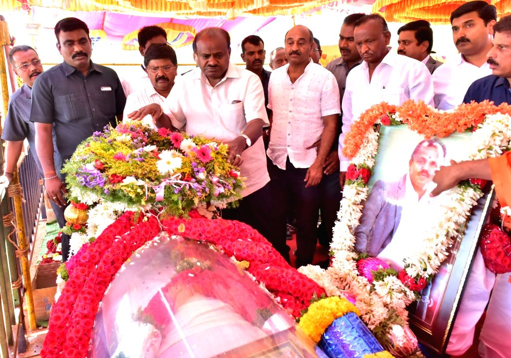 Karnataka Chief Minister H.D. Kumaraswamy pays homage to Shivanna, one of the five Janata Dal-Secular (JD-S) members who were were killed in the Sri Lankan suicide bombings on Easter ... - H.