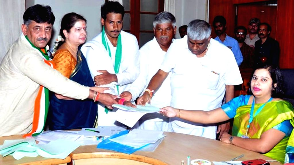 Karnataka Chief Minister H.D. Kumaraswamy's son and JD-S-Congress' Lok Sabha candidate from Mandya Nikhil Kumaraswamy files his nomination in the presence of Congress leader D. K. Shivakumar ... - H.