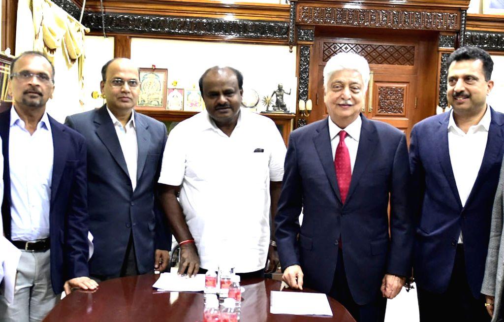 Karnataka Chief Minister H.D. Kumaraswamy with Wipro Chairman Azim Premji during a meeting, in Bengaluru on July 24, 2018. - H.