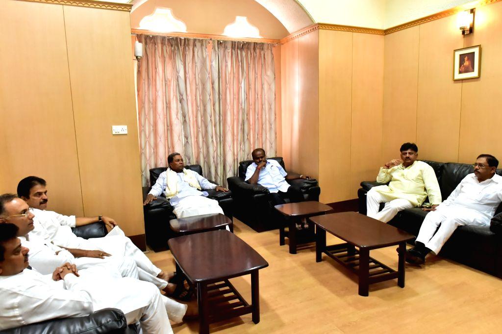 Karnataka Chief Minister H. D. Kumaraswamy with state Congress leaders Dinesh Gundu Rao, K.C. Venugopal, Siddaramaiah, D.K. Shivakumar and G Parameshwar during the Congress Legislature ... - H. D. Kumaraswamy and Dinesh Gundu Rao