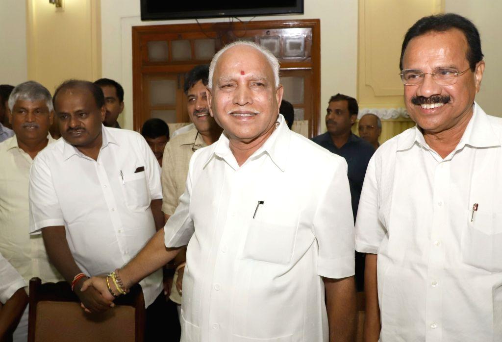 Karnataka Chief Minister H.D. Kumaraswamy with the state's Cabinet Ministers Minister D. V. Sadananda Gowda and D. K. Shivakumar  and Karnataka BJP chief B.S. Yeddyurappa during an ... - H., Minister D. V. Sadananda Gowda and D. K. Shivakumar