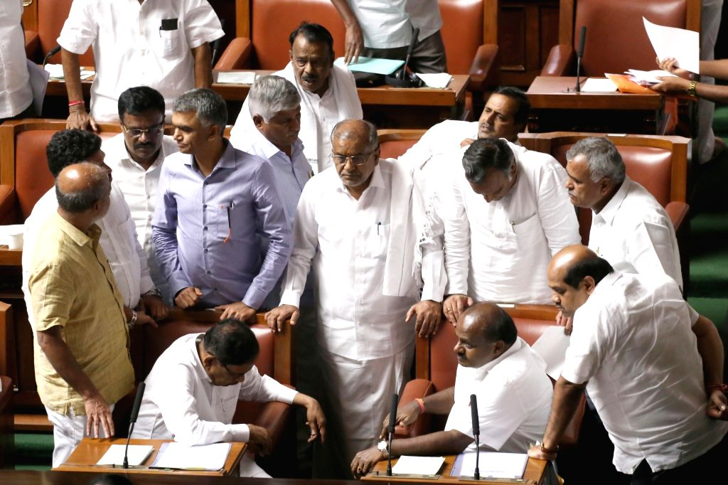 Karnataka Chief Minister H.D. Kumarswamy interacts with his Cabinet Ministers and legislators during the state assembly Monsoon Session, in Bengaluru on July 15, 2019. (Photo: IANS) - H.