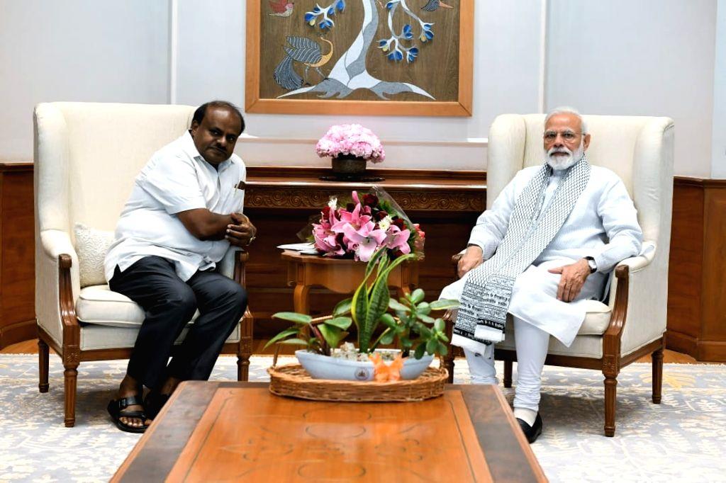 Karnataka Chief Minister HD Kumaraswamy calls on Prime Minister Narendra Modi in New Delhi, on March 9, 2019. - H and Narendra Modi