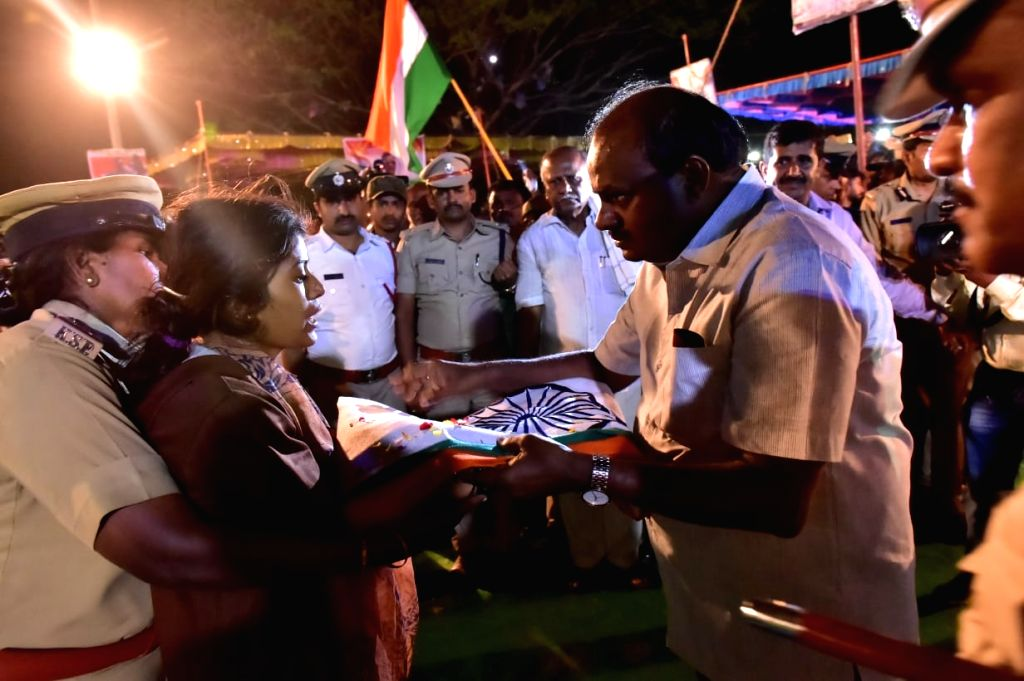 Karnataka Chief Minister HD Kumaraswamy console wife of martyr Guru H who was among the 49 CRPF personnel killed 14 Feb Pulwama militant attack, in Mandya on Feb 16, 2019. - H