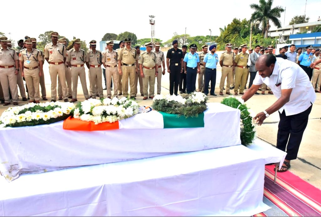Karnataka Chief Minister HD Kumaraswamy pays tribute to Guru H who was among the 49 CRPF personnel killed 14 Feb Pulwama militant attack, in Bengaluru on Feb 16, 2019. - H