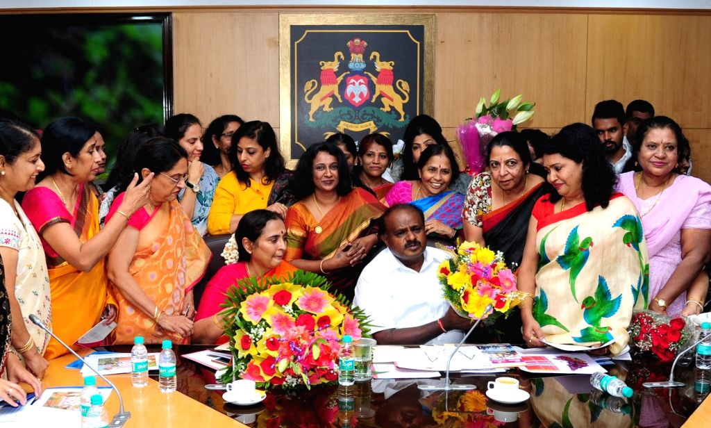Karnataka Chief Minister HD Kumaraswamy seen with woman entrepreneurs during a meeting in Bengaluru on June 2, 2018. - H