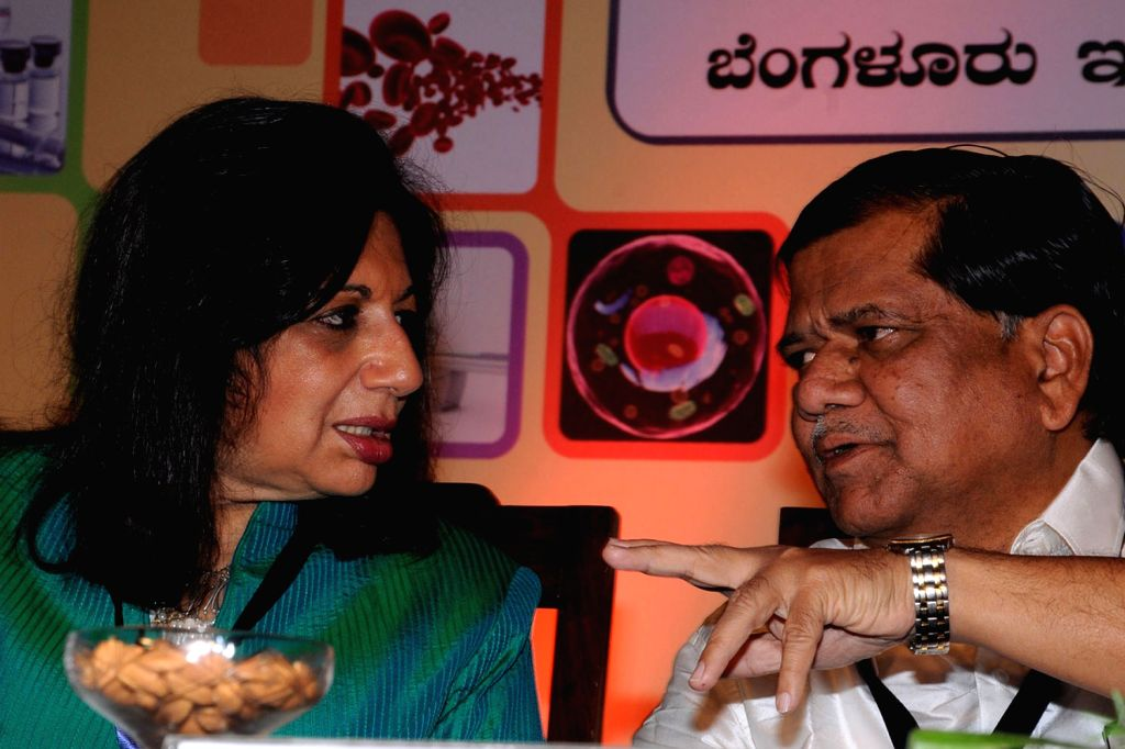 Karnataka Chief Minister Jagadish Shetter discussing with Kiran Mazumdar Shaw, CMD, Biocon during the Bangalore India Biotech Show 2013 at Hotel lalit Ashok, in Bangalore on Monday 4th of February ... - Jagadish Shetter