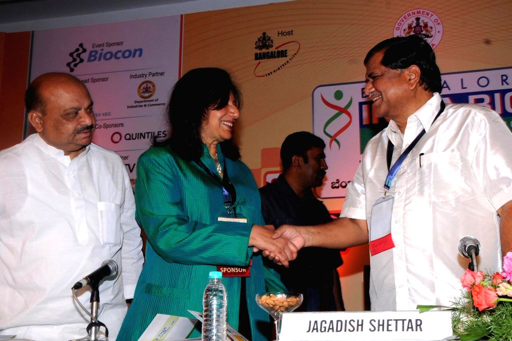 Karnataka Chief Minister Jagadish Shetter greeting  with Kiran Mazumdar Shaw, CMD, Biocon during the Bangalore India Biotech Show 2013 at Hotel lalit Ashok, in Bangalore on Monday 4th of February ... - Jagadish Shetter