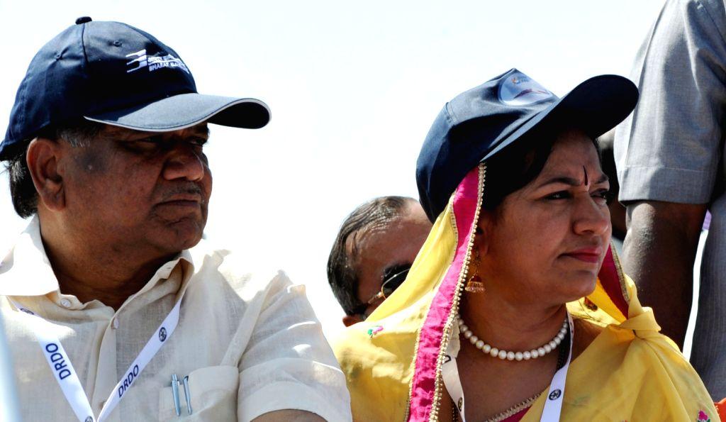 Karnataka Chief Minister Jagadish Shetter and his wife Shilpa Jagadish Shetter watching Aero India Show at the inauguration of 9th Edition of Aero India Show 2013 at Yelahanka Air force Station in ... - Jagadish Shetter