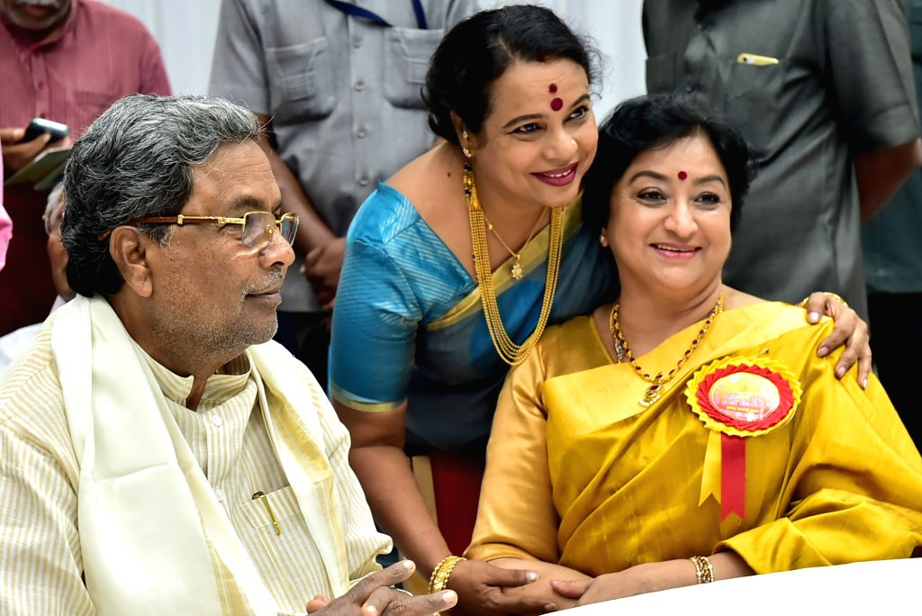 Karnataka Chief Minister Siddaramaiah and minister K J George during inauguration of  61st Kannada Rajyotsava Day celebrations at Kanteerva Stadium in Bengaluru, on Nov 1, 2016. - Siddaramaiah