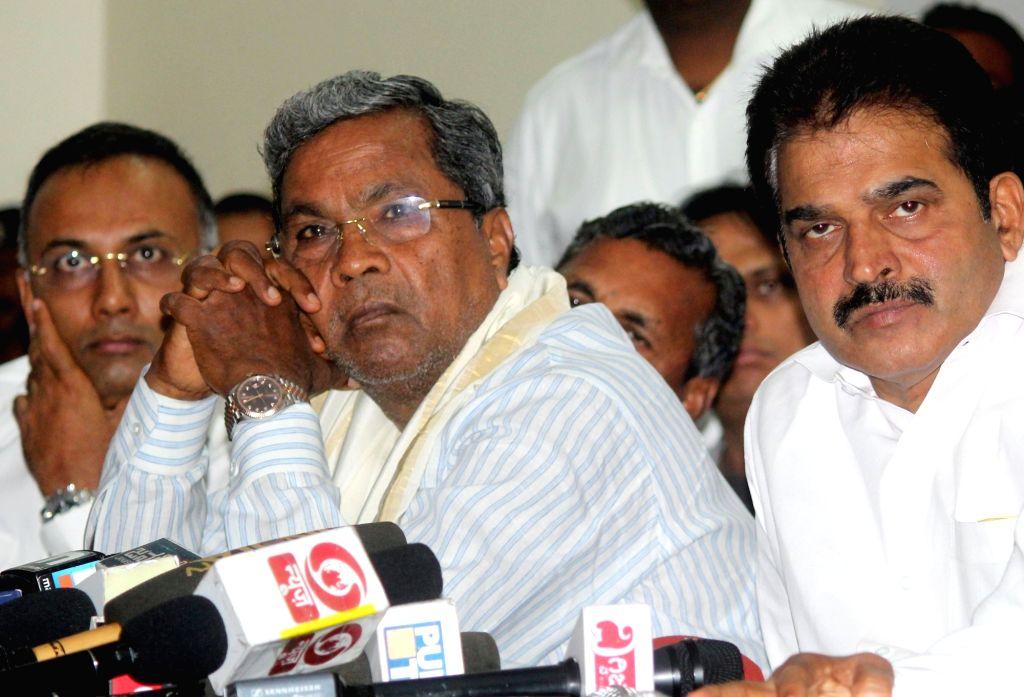 Karnataka Chief Minister Siddaramaiah and Congress leader KC Venugopal during a party meeting in Bengaluru on May 26, 2017. - Siddaramaiah
