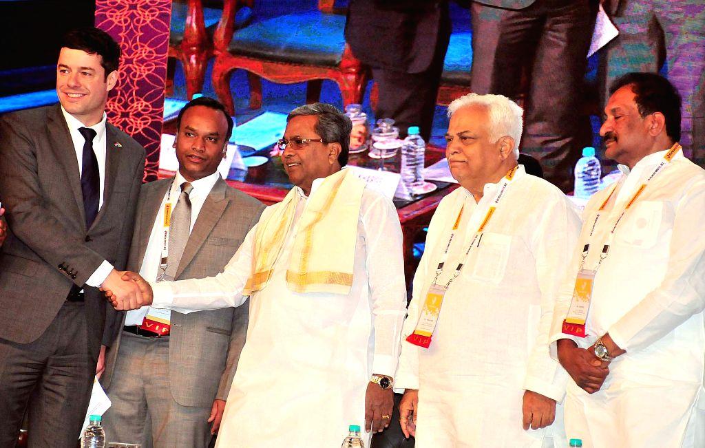 "Karnataka Chief Minister Siddaramaiah and Hague Deputy Mayor Karsten Klein during the inauguration of Bengaluruite.Biz-2016 ""Define The Next' conference in Bengaluru on Nov 28, 2016. - Siddaramaiah"