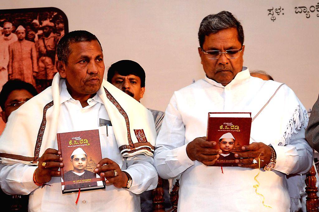 Karnataka Chief Minister Siddaramaiah and others during launch of first Chief Minister of Karnataka KC Reddy's biography at Vidhan Soudha in Bangalore on July 25, 2014. - Siddaramaiah