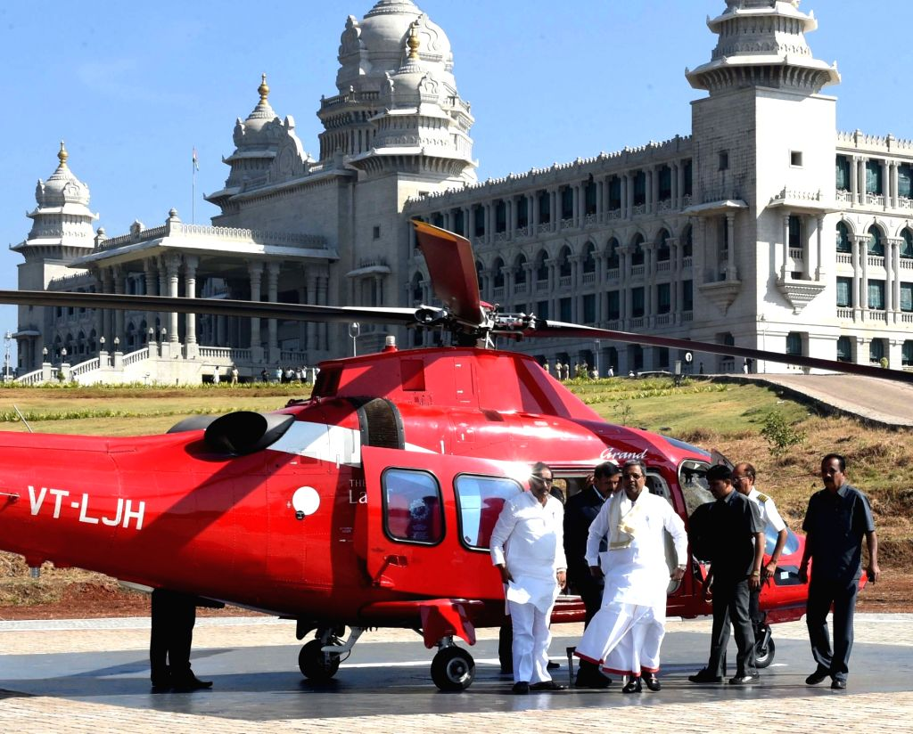 Karnataka Chief Minister Siddaramaiah arrives from a helicopter, after a new helipad constructed at Suvarna Soudha in Belagavi, for the winter session of the Karnataka Assembly on Nov 22, ... - Siddaramaiah
