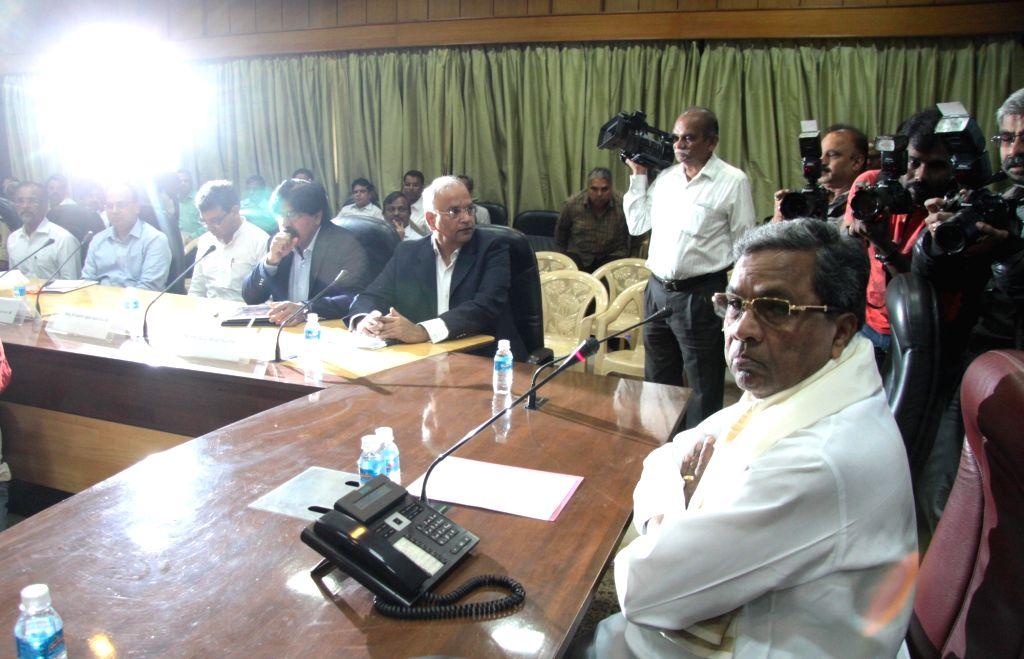 Karnataka Chief Minister Siddaramaiah attends a meeting at his residence in Bengaluru on Aug 3, 2016. - Siddaramaiah
