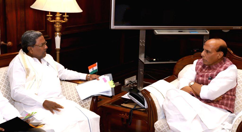 Karnataka Chief Minister Siddaramaiah calls on Union Home Minister Rajnath Singh in New Delhi on Aug 17, 2017. - Siddaramaiah and Rajnath Singh
