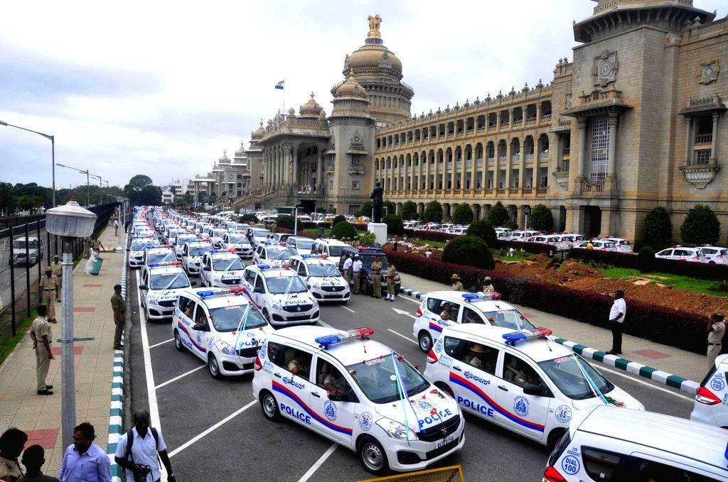 Karnataka Chief Minister Siddaramaiah flags-off the 222 Hi Tech Hoysala Patrol Vehicles at Vidhan Soudha, in Bengaluru on July 2, 2016. - Siddaramaiah