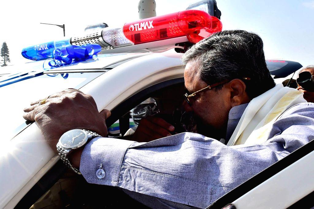 Karnataka Chief Minister Siddaramaiah flags-off Highway Patrol Police Vehicles at Vidhana Soudha in Bengaluru, on Jan 16, 2017. - Siddaramaiah