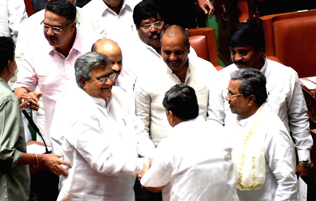 Karnataka Chief Minister Siddaramaiah greets KB Koliwad, newly elected Speaker of Karnataka Legislative at Vidhana Soudha, in Bengaluru on July 5, 2016. - Siddaramaiah