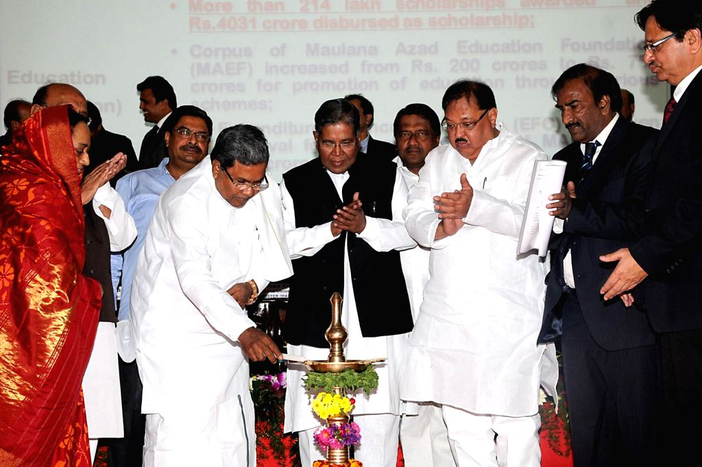Karnataka Chief Minister Siddaramaiah inaugurates ``Southern Regional conference of NGOs of The Ministry of Minority Affairs at Sathanur Village Bagalur. Also seen K Rahman Khan, Union Minister, ... - K Rahman Khan