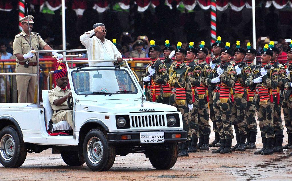 Karnataka Chief Minister Siddaramaiah inspects guard of honour during IndependenceDay programme in Bengaluru on Aug 15, 2017. - Siddaramaiah