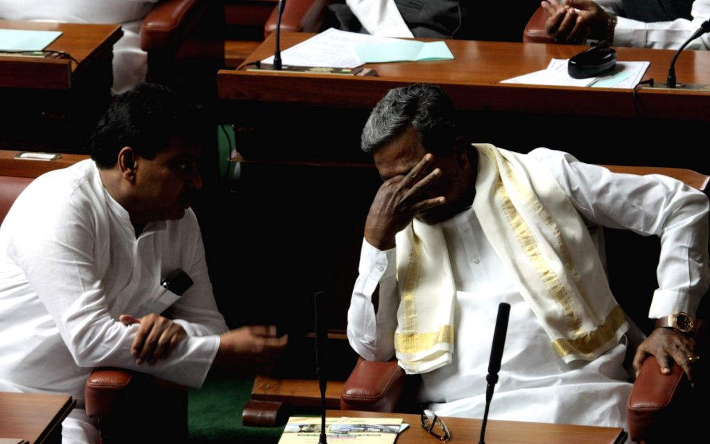 Karnataka Chief Minister Siddaramaiah interacts with legislature M B Patil on the first day of Winter Assembly Session at Vidhan Soudha, in Bengaluru on Nov. 16, 2015. - Siddaramaiah and M B Patil