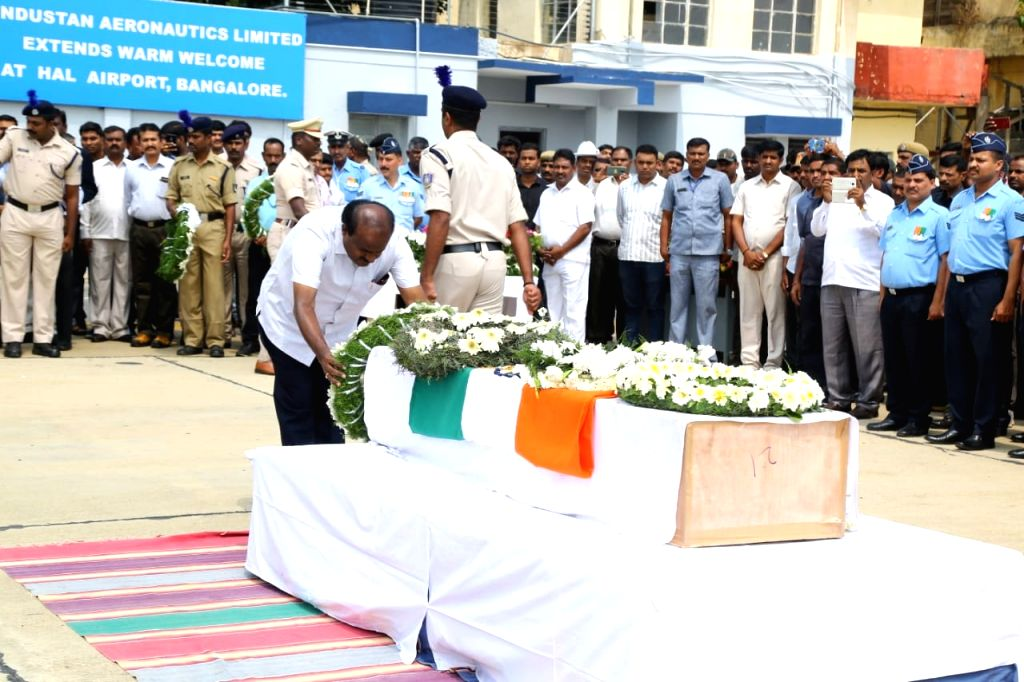 Karnataka Chief Minister Siddaramaiah pays tribute to Guru H who was among the 45 CRPF personnel killed 14 Feb Pulwama militant attack, in Bengaluru on Feb 16, 2019. - Siddaramaiah