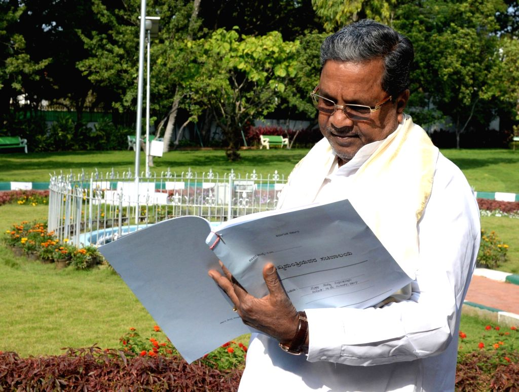Karnataka Chief Minister Siddaramaiah prepares the 2017 budget copy at his official residence, in Bengaluru on March 14, 2017. - Siddaramaiah