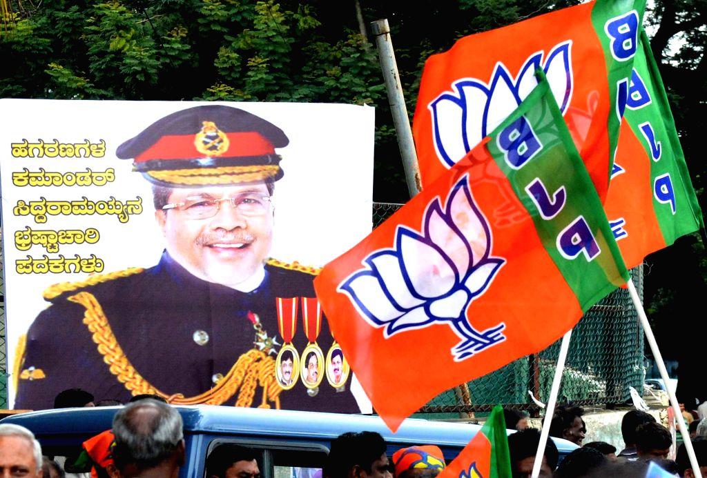 Karnataka Chief Minister Siddaramaiah's morphed poster during BJP's demonstration in Bengaluru on Aug 18, 2017. - Siddaramaia