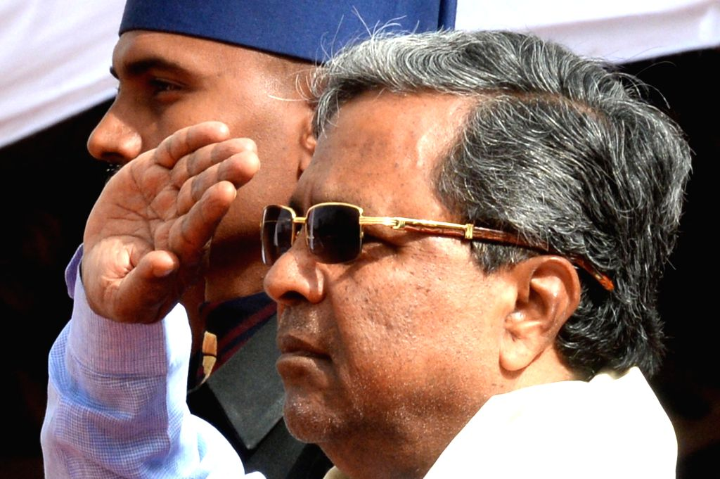 """Karnataka Chief Minister Siddaramaiah salutes the national flag on the occasion of 70th """"Independence Day"""" celebration in Bengaluru on Aug 15, 2016. - Siddaramaiah"""