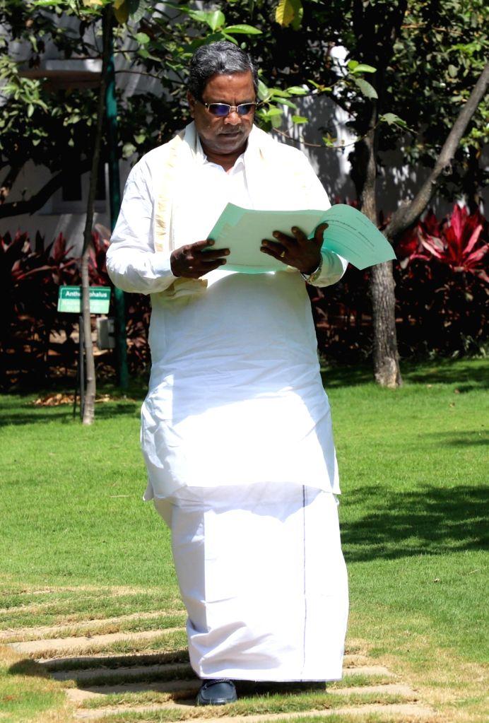 Karnataka Chief Minister Siddaramaiah takes a look at Karnataka State budget documents at his residence in Bengaluru on Feb 15, 2018. The state budget is to be announced tomorrow. - Siddaramaiah