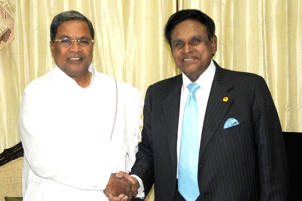 Karnataka Chief Minister Siddaramaiah with Malaysia's special envoy to India Datuk Seri S. Samy Vellu in Bangalore on July 16, 2014. - Siddaramaiah