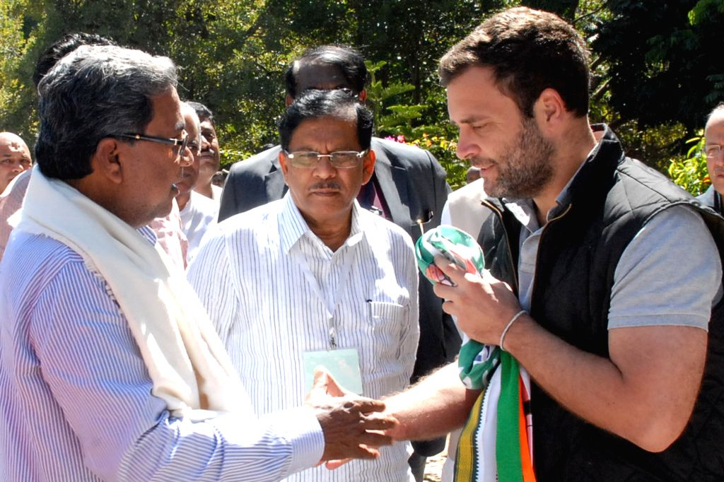 Karnataka Chief Minister Siddaramaiah with Congress vice president Rahul Gandhi in Bengaluru, on Nov 25, 2015. - Siddaramaiah