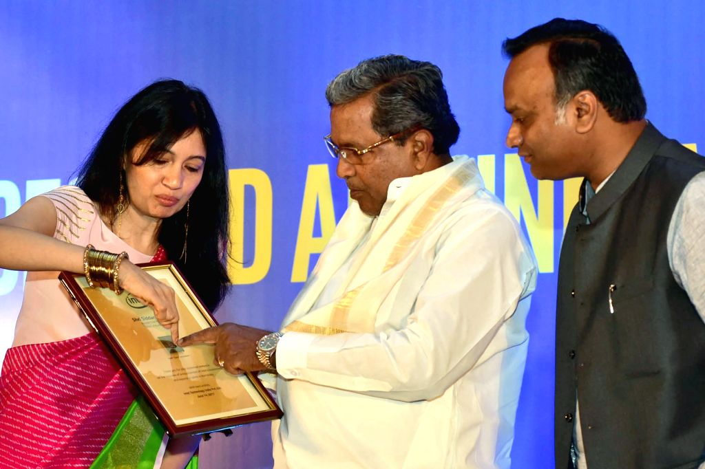 Karnataka Chief Minister Siddaramaiah with Karnataka IT minister Priyank Kharge and Intel India General Manager Nivruti Rai during a press conference to announce US-based multinational's ... - Siddaramaiah and Manager Nivruti Rai