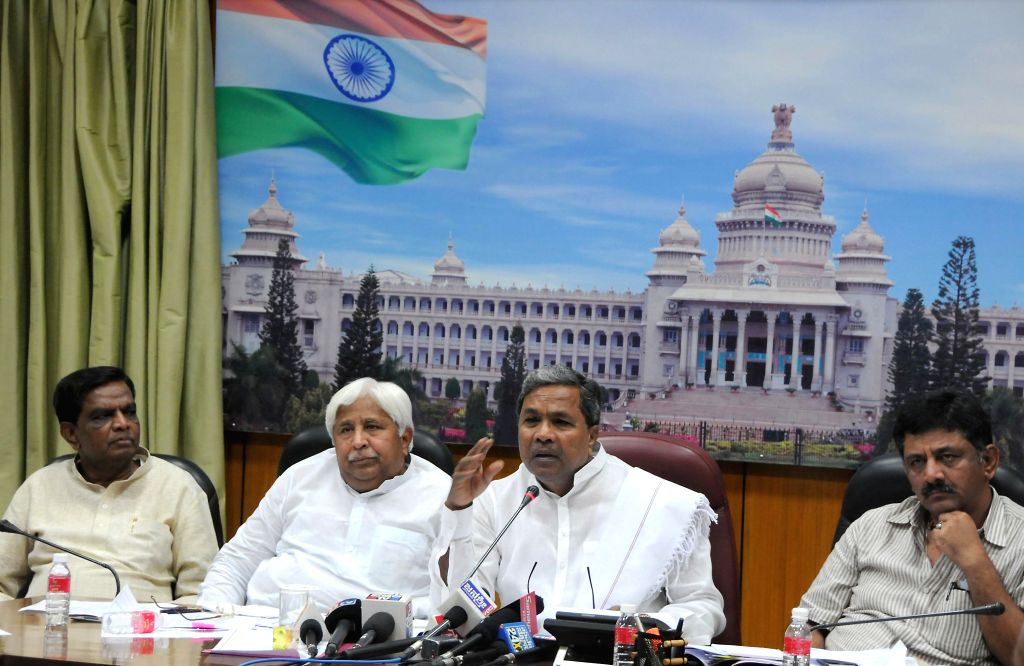 Karnataka Chief Minister Siddaramiah, Karnataka Minister for Rural Development and Panchayat Raj H.K. Patil, Karnataka Energy Minister DK Shivakumar and others during a meeting in Bangalore on May 8, - K. Patil