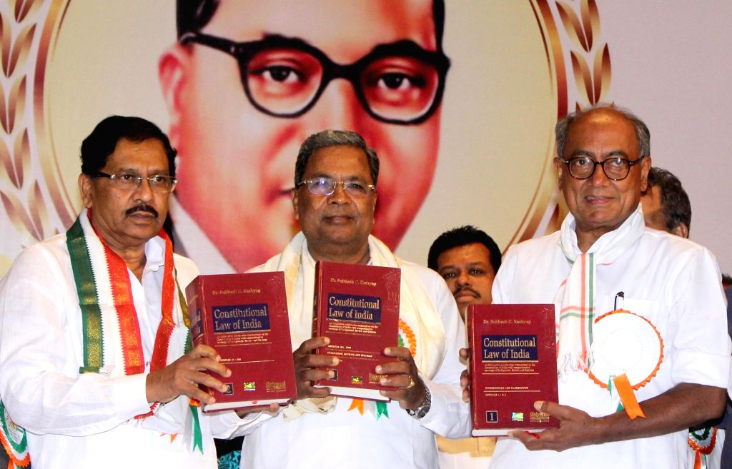 """Karnataka Chief Minister Siddaramiah with Digvijay Singh and other Congress leaders during a programme organised to launch the book """"Constitutional Law of India"""" on the eve of Dr ... - Siddaramiah and Digvijay Singh"""