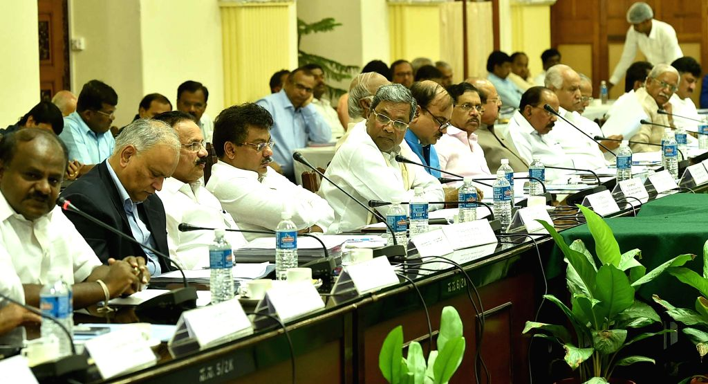 Karnataka Chief Minister Siddharamaiah, Union Ministers DV Sadananda Gowda, Ananth Kumar, Karnataka Home Minister Dr. G Parameshwara, Minister M B Patil during the all party meeting on ... - Siddharamaiah, Ananth Kumar and M B Patil