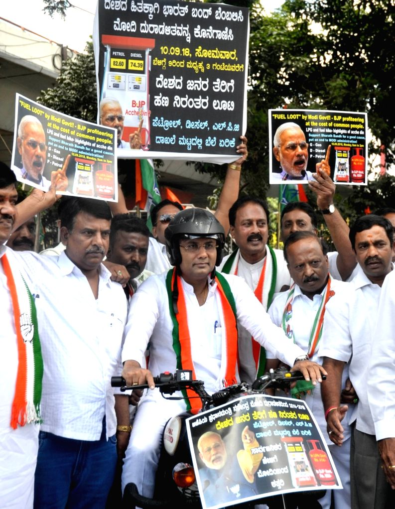 Karnataka Congress chief Dinesh Gundu Rao participates in a bike rally along with party workers to protest against hike in the prices of fuel, in Bengaluru on Sept 8, 2018. - Dinesh Gundu Rao