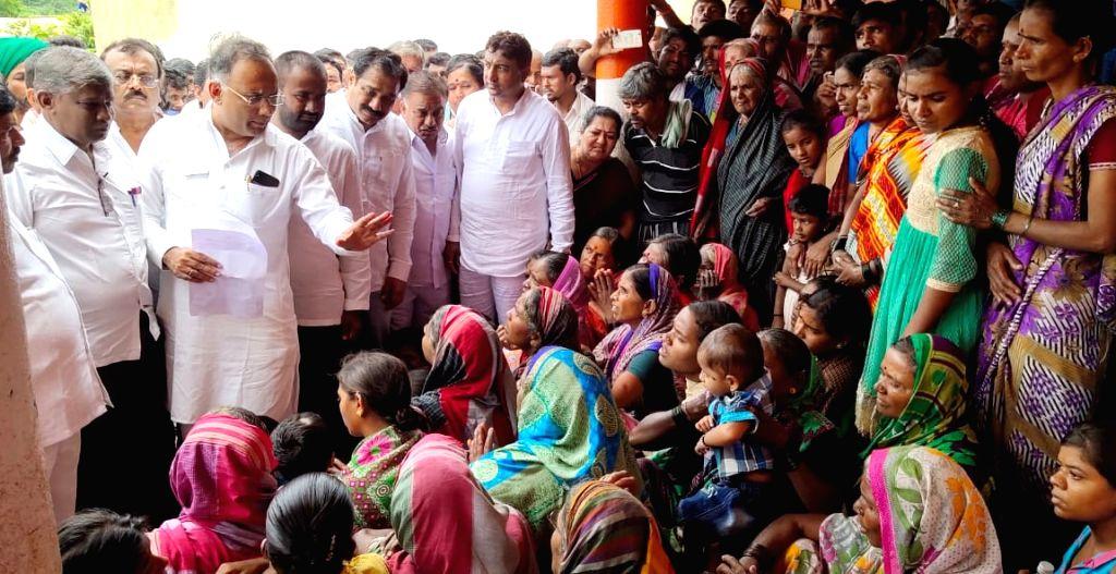 Karnataka Congress chief Dinesh Gundu Rao interacts with flood victims during his visit to Karnataka's flood affected Hubballi, on Aug 10, 2019. - Dinesh Gundu Rao