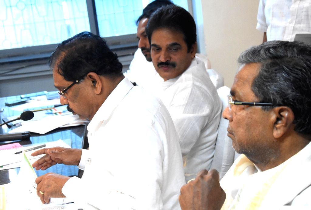 Karnataka Congress chief Dr. G Parameshwara and newly appointed party's Karnataka In-Charge K. C. Venugopal during a party meeting in Bengaluru, on May 10, 2017.