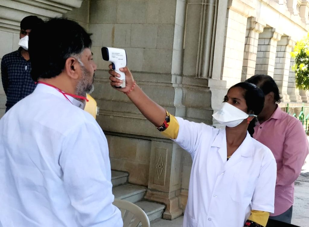Karnataka Congress President D. K. Shivakumar being screened for COVID-19 as he arrives at Vidhana Soudha to attend an All Party meeting, on Day 5 of the 21-day countrywide lockdown ...