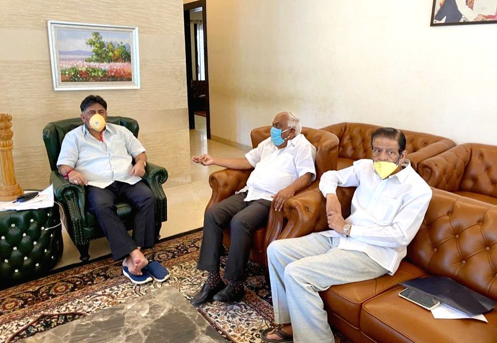 Karnataka Congress President DK Shivakumar holds a meeting with party leader K. R. Ramesh Kumar at his residence on Day 4 of the lockdown imposed in the wake of the coronavirus pandemic, ...