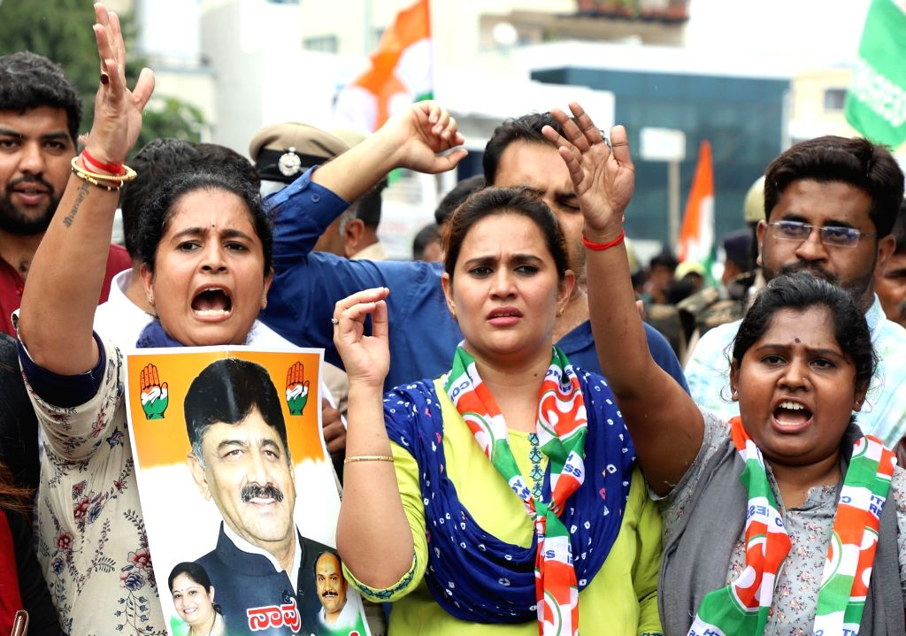 Karnataka Congress workers stage a demonstration against the arrest of senior party leader D.K. Shivakumar, in Bengaluru on Sep 4, 2019.
