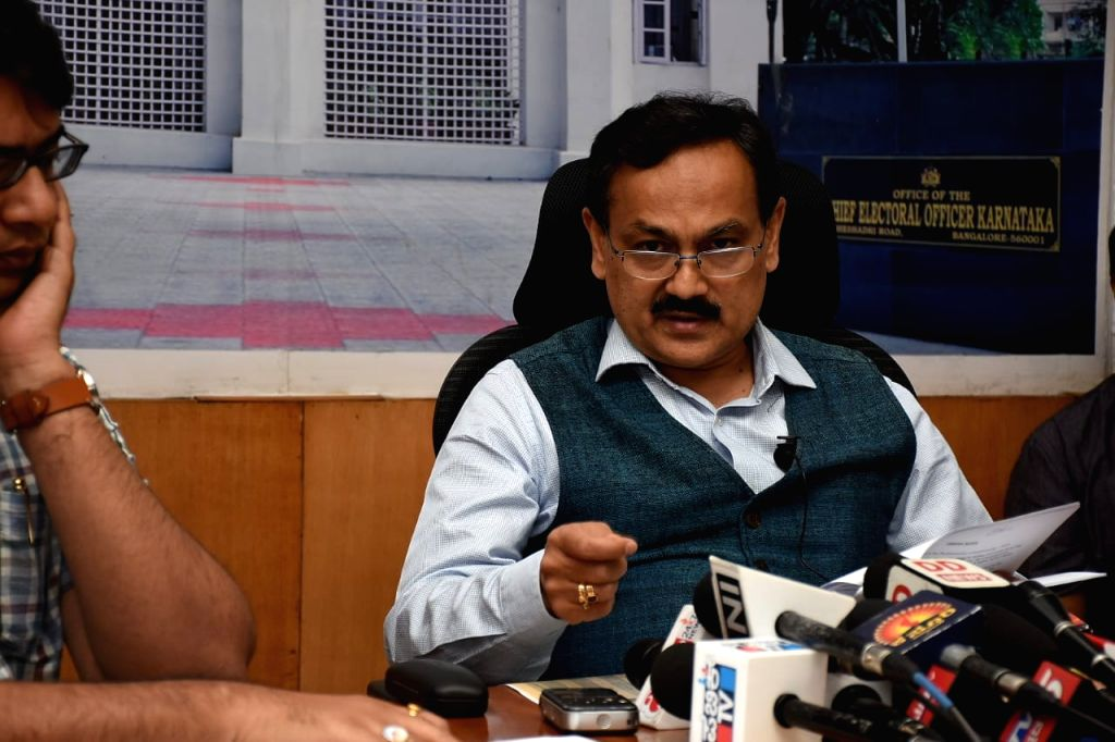 Karnataka Election Commissioner Chief Sanjiv Kumar addresses a press conference at the Chief Election Commission office, in Bengaluru on March 10, 2019.
