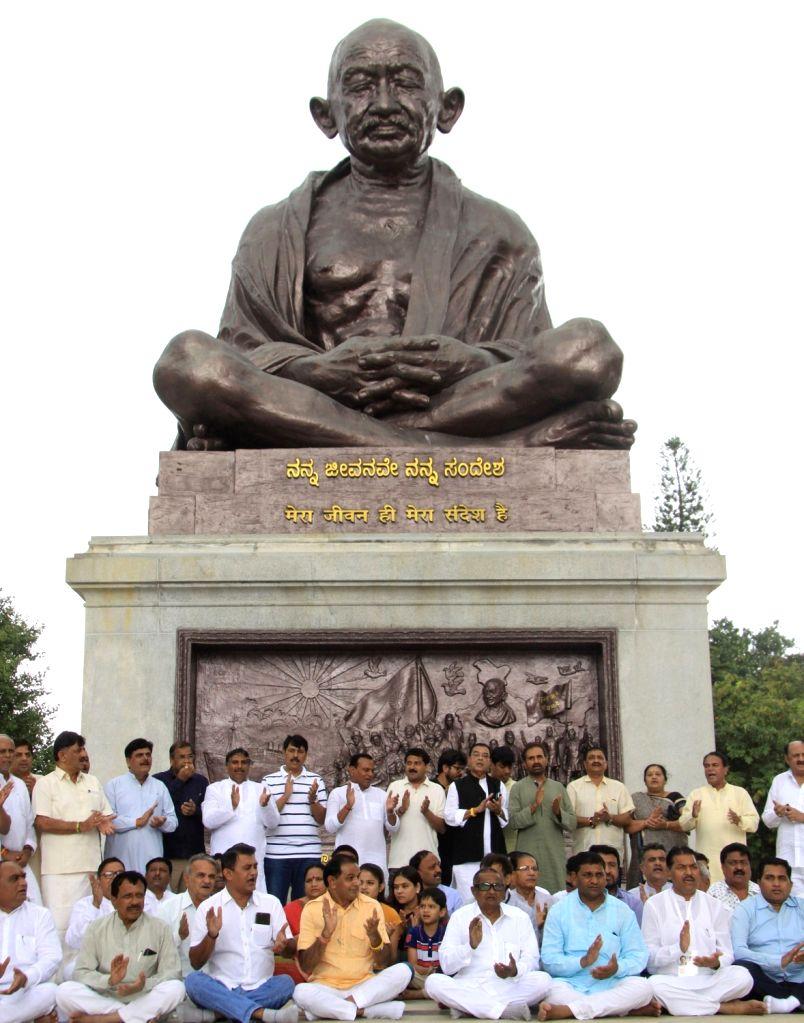Karnataka Energy Minister DK Shivakumar in front of Gandhi Statue with Gujarat Congress MLAs in Bengaluru on Aug 5, 2017. - D