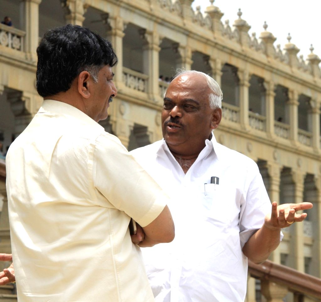 Karnataka Energy Minister DK Shivakumar interacts Health Minister K. R. Ramesh Kumar at his residence after Income tax department raids in Bengaluru on Aug 5, 2017. - D